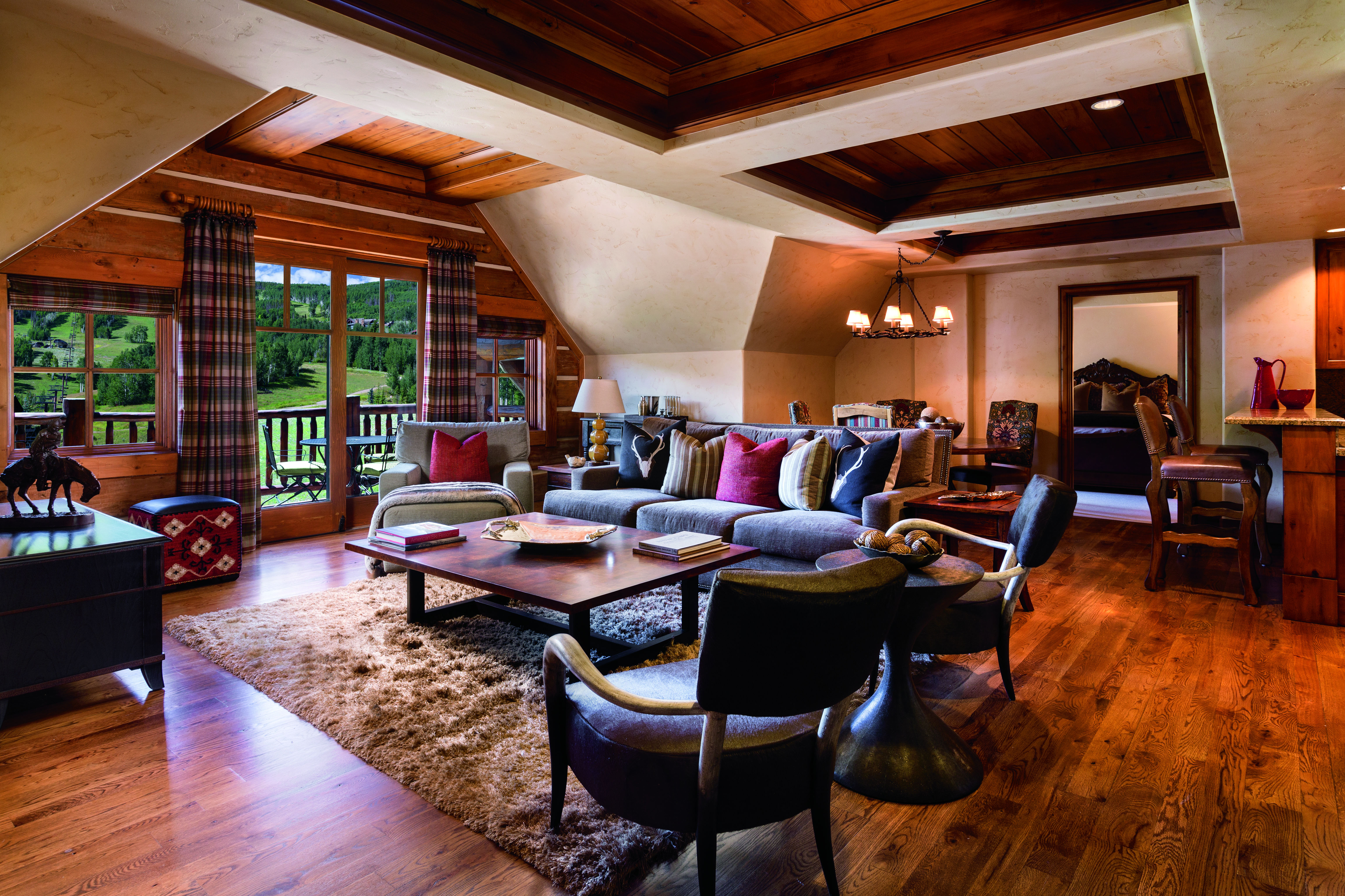 Large living room with contemporary wood ceilings